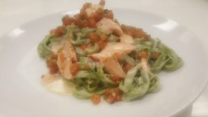 Spinach tagliatelle with hot smoked salmon tomatoes and lemon cream reduced
