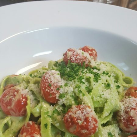 Fresh spinach tagliatelle with blisterred tomatoes