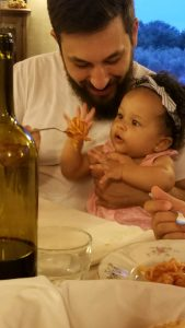 Six month old Harper enjoying pasta with her father!